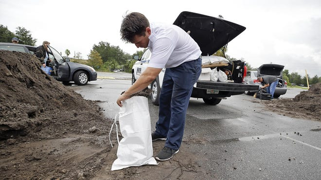 A man fills sandbags at a public works site in Casselberry as he prepares for Hurricane Irma in 2017.