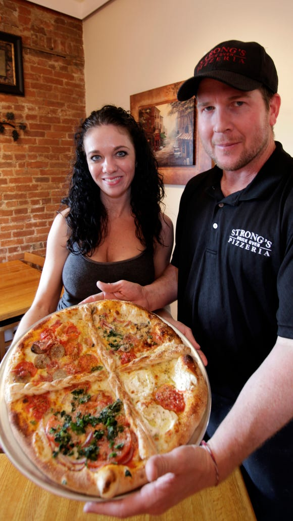 Wednesday, April 18, 2012: MMX STRONG'S PIZZA:  Christian and Mindy Strong, (cq) are the owners of Strong's Brick Oven Pizzeria
