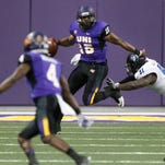 Northern Iowa quarterback Aaron Bailey, center, eludes a tackle by Eastern Illinois' JarvisWilliams, right, during the first half of a first-round NCAA college football FCS playoff game Saturday, Nov. 28, 2015, in Cedar Falls, Iowa.
