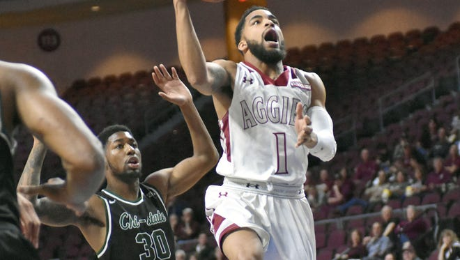 New Mexico State's Shunn Buchanan goes up for an easy layup as the Aggies took on Chicago State in the the quarterfinal round of the Western Athletic Conference Tournament in Las Vegas, Nevada.