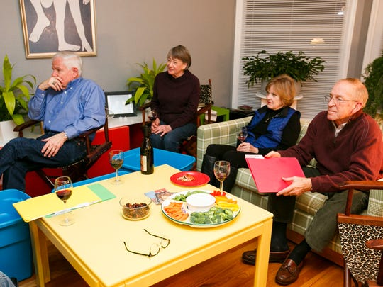 (Left to right) Brete and Jean Harrison, and Linda and Jim Thomas listen to information about the Cascadia Subduction Zone earthquake at Catherine Webber's house on Thursday, Feb. 2, 2017. Webber hosts dinners where she gives out earthquake preparedness kits to friends and talks about the Cascadia Subduction Zone earthquake.