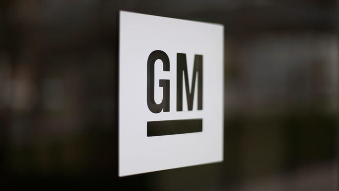 FILE - This Friday, May 16 2014, file photo, shows the General Motors logo at the company's world headquarters in Detroit.