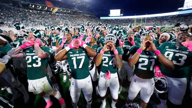 Michigan State football players had plenty to celebrate after beating Indiana on Saturday, Oct. 21, 2017. The Spartans are bowl eligible after finishing 3-9 last season, and they are in the thick of the Big Ten title hunt.