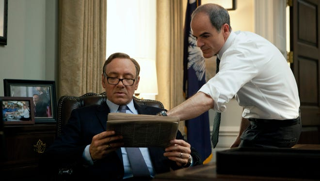 "Kevin Spacey, left, and Michael Kelly appear in a scene from ""House of Cards."" The third season of the political drama will be available on Netflix on Friday Feb. 27, 2015."