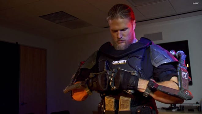 Clay Matthews straps on an exo suit during his day as an intern at Sledgehammer Games.