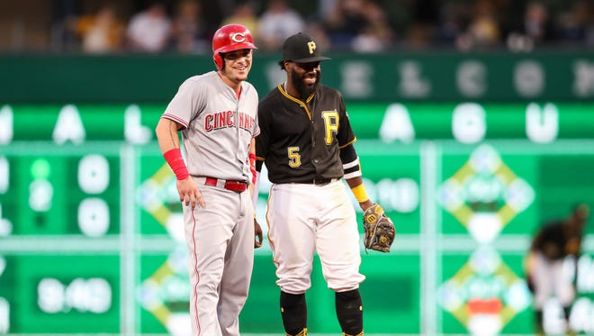 Cincinnati Reds second baseman Scooter Gennett (3) and Pittsburgh Pirates second baseman Josh Harrison (5) both smile during the fifth inning at PNC Park.