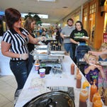 Fricker's employees serve samples to diners during the Taste of Wayne County at Richmond Square Mall.