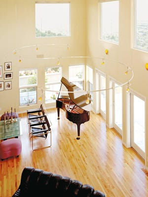Track lighting is useful in spaces where homeowners don't want to — or can't — run electrical wires through a ceiling.