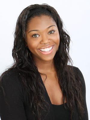 """Mariyah Thurston skates the role of Tiana in Disney on Ice's """"Let's Celebrate!"""""""
