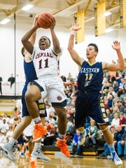 Central York's Onterio Edmonds (11) drives to the basket against Eastern York's Broguen Nicholas (4) and Jarad Woods (10) in a YAIAA boys' basketball semifinal game at Red Lion Area High School on Thursday, Feb. 11, 2016. Central York won 64-48.