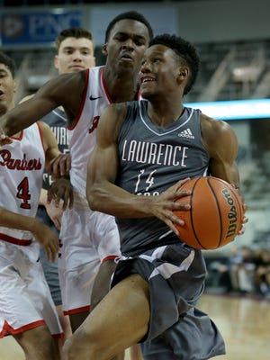 Lawrence Central's Mehki Biffle (14) drives by North Central's Kris Wilkes (31) in the first half of their North Side Madness game at Thursday, Feb 4, 2016, evening at the Indiana Farmers Coliseum.