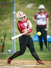 Susquehannock's Lily Yoakum (10) hits an RBI triple against Eastern York in a YAIAA softball game on Monday, April 11, 2016. Susquehannock won 13-0.