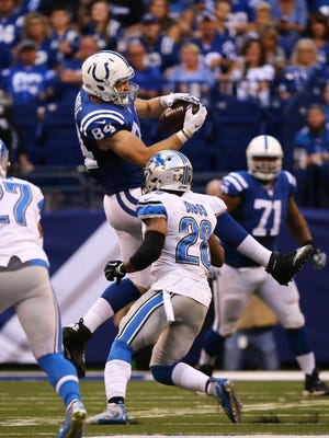 The Colts' Jack Doyle pulls in a pass over the Lions' Quandre Diggs. The Colts had 4 TD catches.