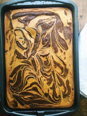 Pumpkin cream cheese swirled chocolate brownies in New York. This dish is from a recipe by Katie Workman.