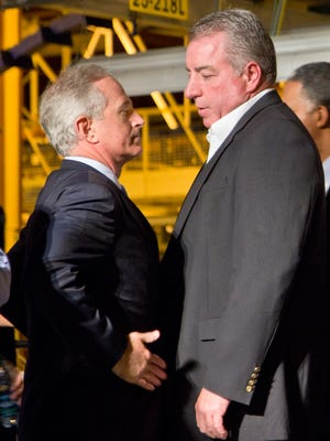 U.S. Sen. Bob Corker, left, speaks with United Auto Workers regional director Gary Casteel after a ceremony announcing renewed auto production at the General Motors plant in Spring Hill on Nov. 21, 2011.