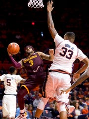 Central Michigan guard Marcus Keene (3) shoots defended