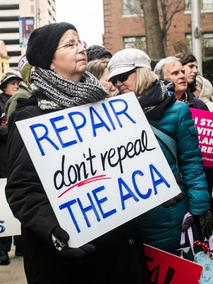 "Nikki Byer, of Etters, holds her ""Repair don't repeal The ACA"" sign during a #TuesdaysWithToomey protest Tuesday, Jan. 31, 2017, outside of the Federal Building in Harrisburg. Amanda J. Cain photo"