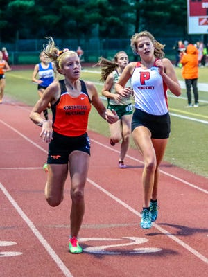 Pinckney's Isabella Garcia (right) finishes just behind Northville's Cayla Eckenroth in the 3,200-meter run at the Division 1 regional at Milford on May 19, 2017. Garcia ran a school-record 11:01.18 to qualify for the state meet.