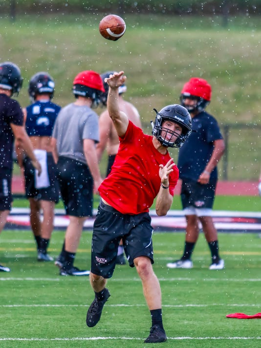 636377372020914832-A-brief-rain-shower-couldn-t-deter-Pinckney-s-Jack-Wurzer-during-Monday-s-practice.jpg