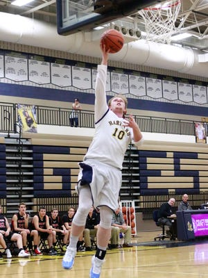 Hartland's Evan Metz makes a layup for two of his game-high 17 points in a 54-49 overtime victory over Pinckney.
