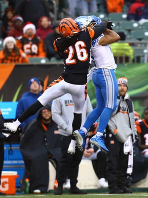 Bengals cornerback Josh Shaw (26) breaks up a pass intended for Lions wide receiver Golden Tate (15) in the second half of the Lions' 26-17 loss on Sunday, Dec. 24, 2017, in Cincinnati.