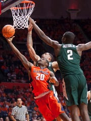 Illinois guard Da'Monte Williams (20) shoots while defended by Michigan State forward Jaren Jackson Jr. (2) during the first half on Monday, Jan. 22, 2018, in Champaign, Ill.