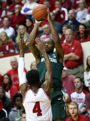 Michigan State Spartans guard Joshua Langford (1) takes a shot against Indiana Hoosiers guard Robert Johnson (4) in the first half at Assembly Hall, Saturday, Feb. 3, 2018.