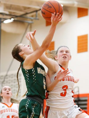 Howell's Alexis Miller, who scored all 18 of her points in the second half, goes to the basket against Northville's Kendall Dillon on Tuesday, Feb. 6, 2018.