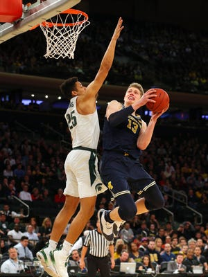 Michigan forward Moritz Wagner (13) drives to the basket against Michigan State forward Kenny Goins (25) during the first half of a semifinal game of the 2018 Big Ten Tournament at Madison Square Garden.