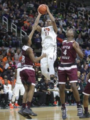 River Rouge guards Bralin Toney and Legend Geeter defend Benton Harbor forward Carlos Johnson during the second quarter of the Class B MHSAA semifinals Friday, March 23, 2018, at the Breslin Center in East Lansing.