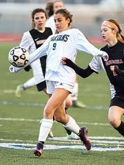 Stevenson's Zelia Griffith (9) keeps control of the