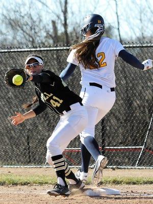 Howell's AJ Militello (41) and Hartland's Delanie Grundman (22) will play in regional softball tournaments Saturday.