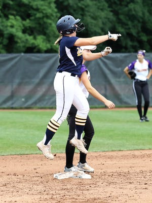 Sam Nagel celebrates a three-run double that gave Hartland a 3-1 lead in the first inning against Caledonia in the state Division 1 softball championship game on Saturday, June 16, 2018.