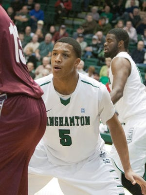 Binghamton University forward Magnus Richards gets into a defensive stance during a game against Colgate in the Events Center in December 2013.