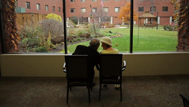 "In 2017 Martin J. Schreiber looks out into a courtyard as he visits his wife, Elaine Schreiber, at The Lutheran Home on W. North Ave. in Wauwatosa. In his book ""My Two Elaines"" Schreiber, a former Wisconsin governor, describes caring for his spouse with Alzheimer's disease."