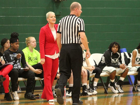 Robin Davis, in her third year as the head coach of the Owls, questions the referee in her team's first home game of the season.