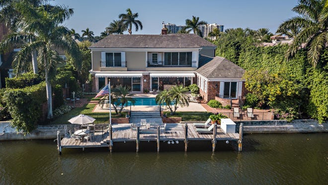 The boat dock and deck area at 568 Island Drive offer wide views that include the Everglades Golf Course.