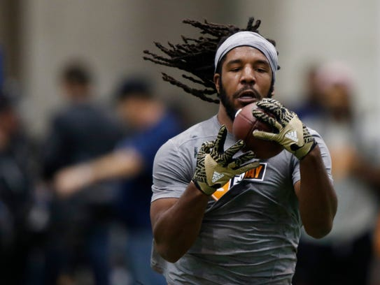 Jalen Reeves-Maybin makes a catch as he competes during
