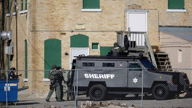 The investigation into a police shooting of a hostage during a standoff in Neenah helped lead to changes and written policies for future such state investigations of officer-involved fatal shootings.