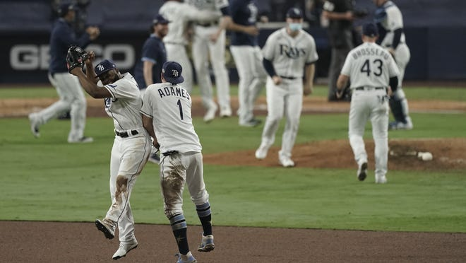 Tampa Bay's Manuel Margot and Willy Adames celebrate their victory in Game 7 on Saturday.