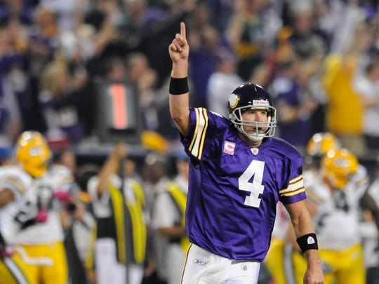 Minnesota Vikings quarterback Brett Favre (4) reacts after throwing a touchdown against the Green Bay Packers at the Metrodome in Minneapolis, Minn., Monday, October 5, 2009.