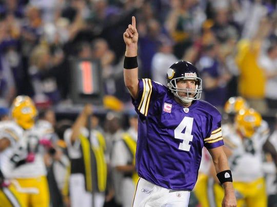 Minnesota Vikings quarterback Brett Favre (4) reacts