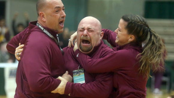 Ossining head coach Dan Ricci, center, celebrates with