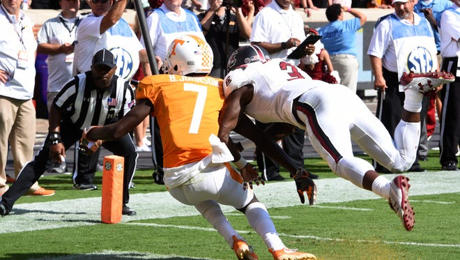 Tennessee wide receiver Brandon Johnson (7) misses a pass in the final second of the game while defended by South Carolina defensive back Chris Lammons (3) during a Tennessee vs. South Carolina game at Neyland Stadium in Knoxville, Tenn. Saturday, Oct. 14, 2017. South Carolina defeated Tennessee 15-9.