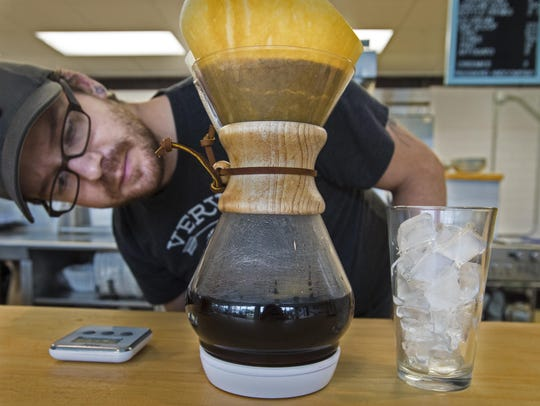 Andy Burke brews iced coffee at Scout and Co. in Burlington