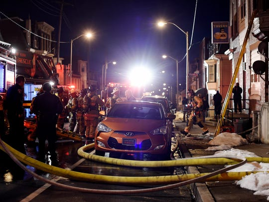 Crews extinguish a fire on the 700 block  of East Market