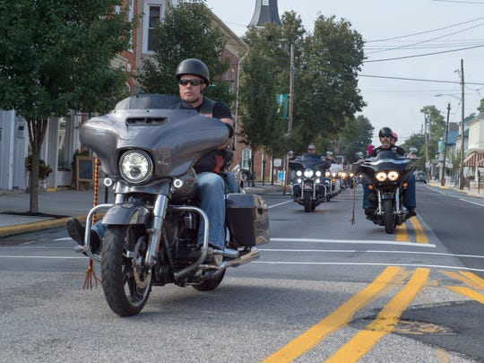 Motorcylists ride through downtown Greencastle during the 3rd annual Flight 93 Memorial Ride on Saturday. Sept. 10, 2016.