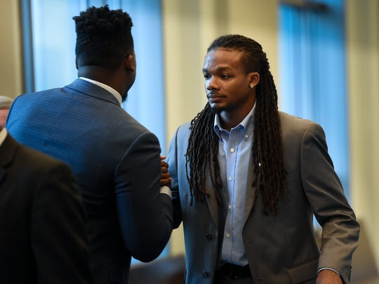 Defendant Brandon E. Banks (rt) greets his friend and defense witness Lardarius Banks in the hall before starting the fourth day of testimony in the Vanderbilt rape case at the Justice A.A. Birch Building Thursday, June 22, 2017, in Nashville, Tenn.