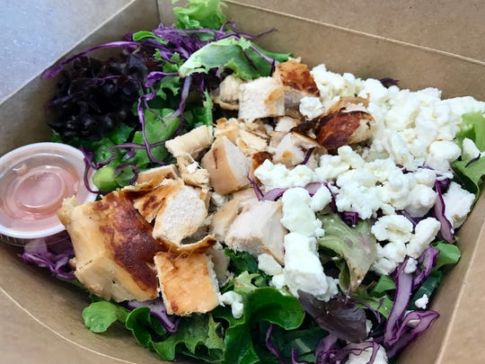 A Fibrre box with a base of brown rice, loads of vegetables, grilled chicken and feta.