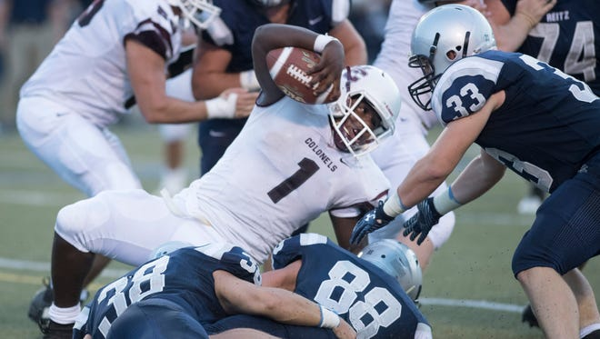 Henderson County's Skip Peterson (1) is brought down by the Reitz defense at the Reitz Bowl Friday night.